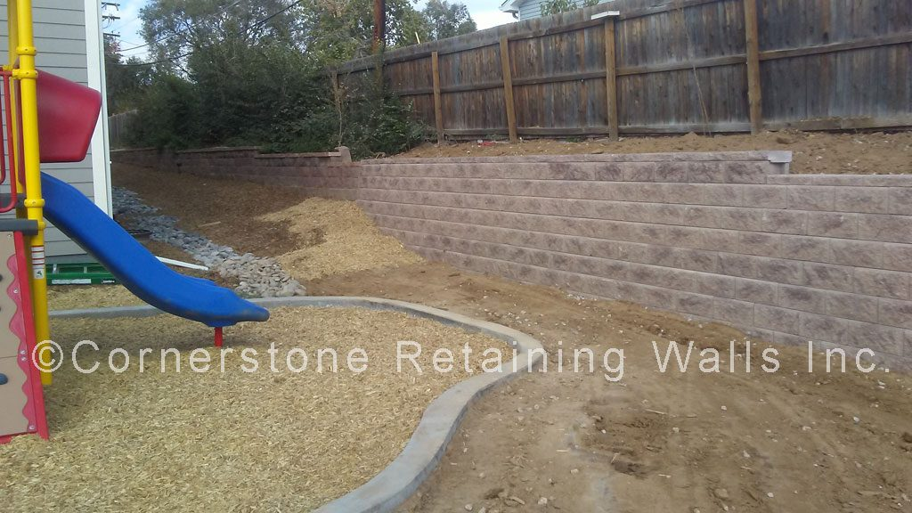 Allan Block tan blend retaining wall built with Classic block.